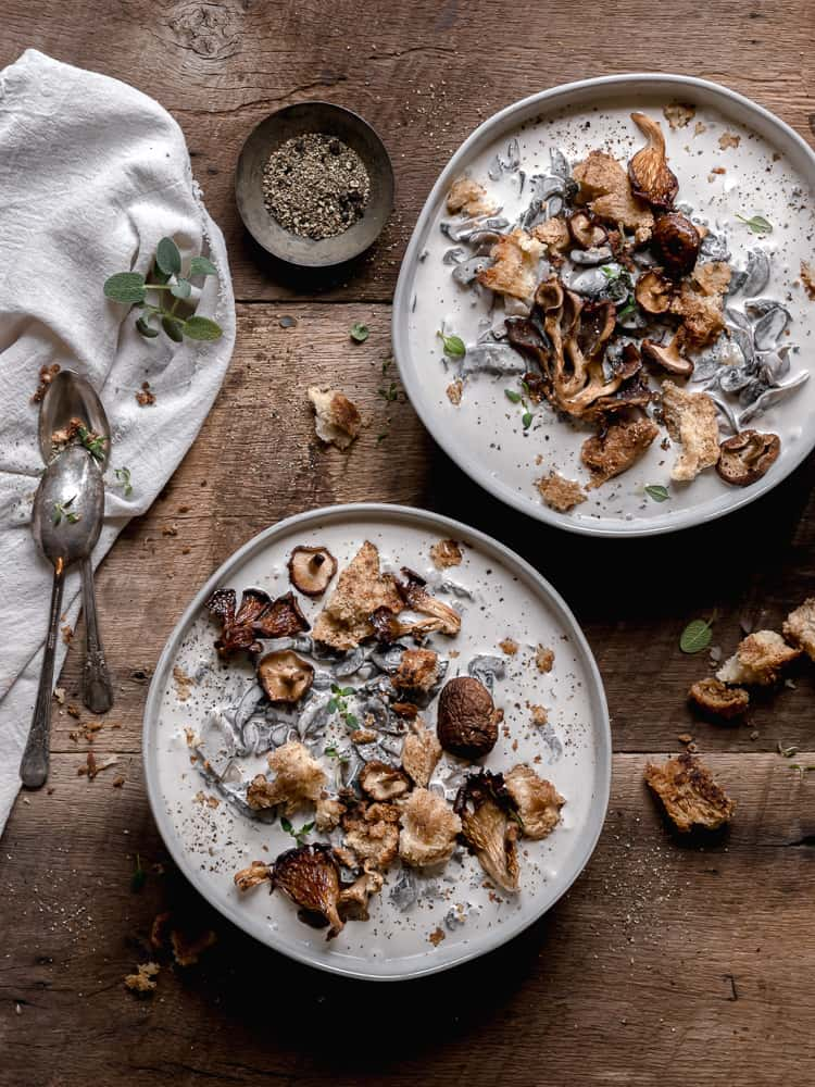 two bowls of cream of mushroom soup