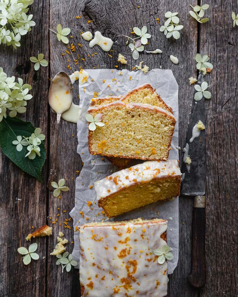 overhead shot of sliced and glazed orange pound cake