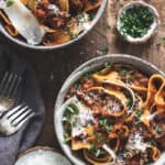Two bowls of pappardelle bolognese