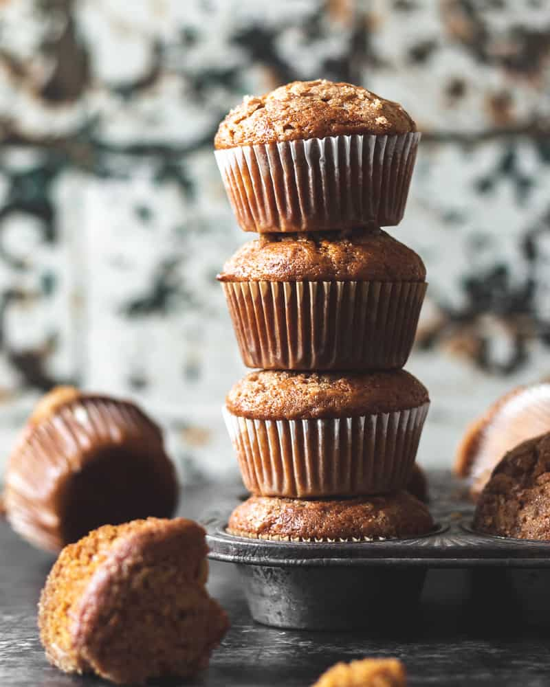 straight on shot of tall stack of muffins in muffin tin