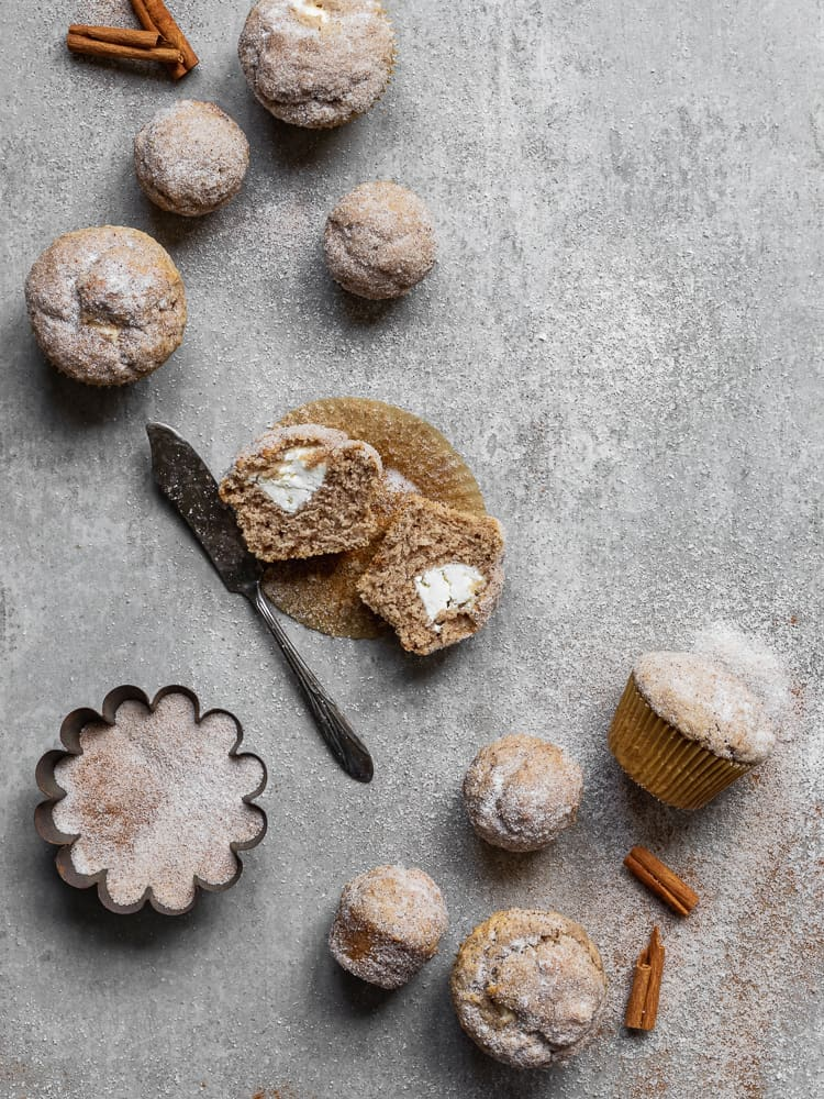 muffins on gray surface with antique butter knife