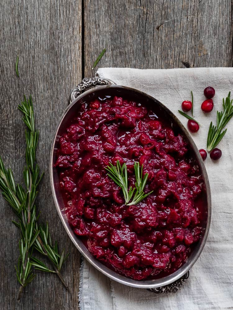 cranberry sauce in silver dish with rosemary