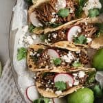 Barbacoa Beef Tacos in serving dish with toppings