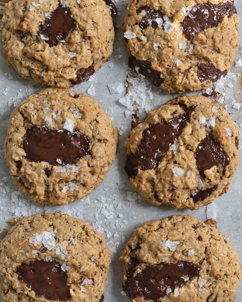 overhead shot of peanut butter oatmeal cookies on parchment paper