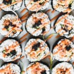 overhead of spicy salmon sushi rolls