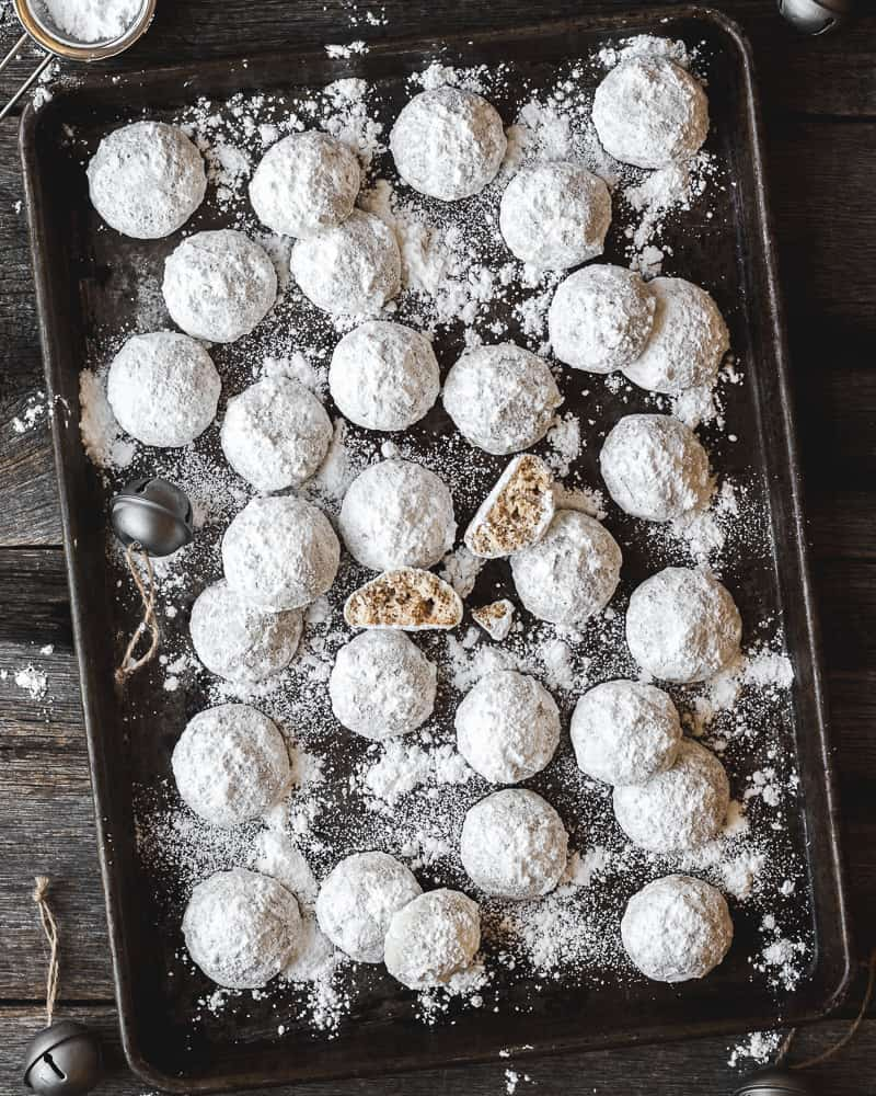 pecan snowball cookies on baking tray