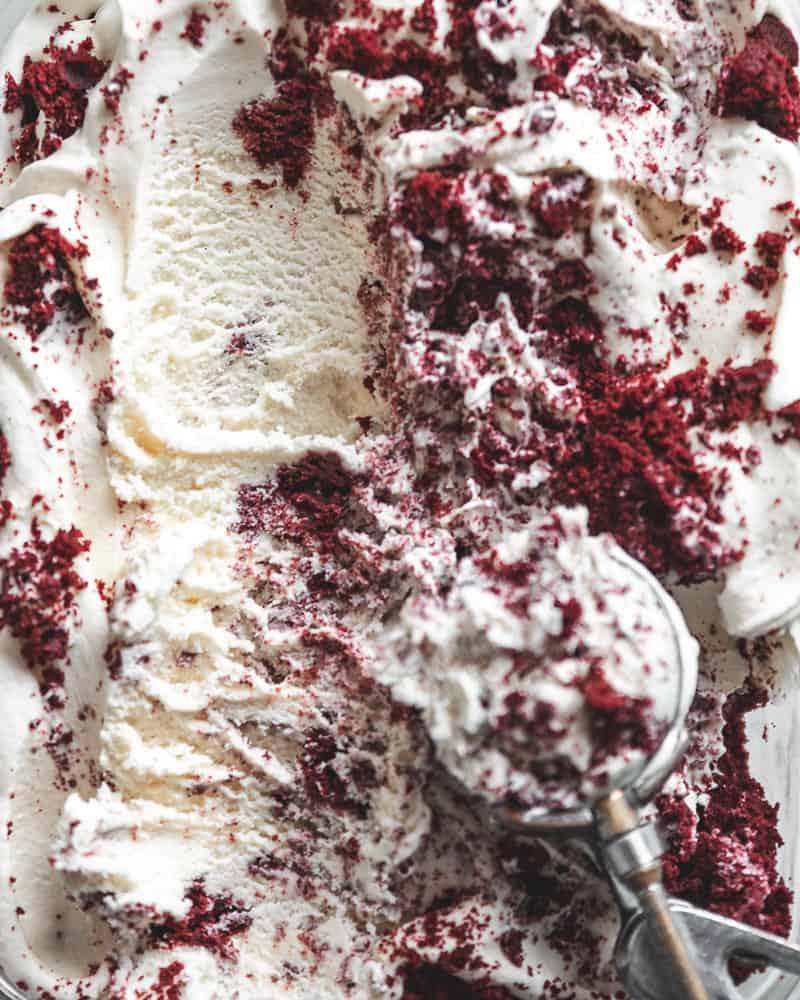 full container of red velvet cake ice cream with ice cream scoop