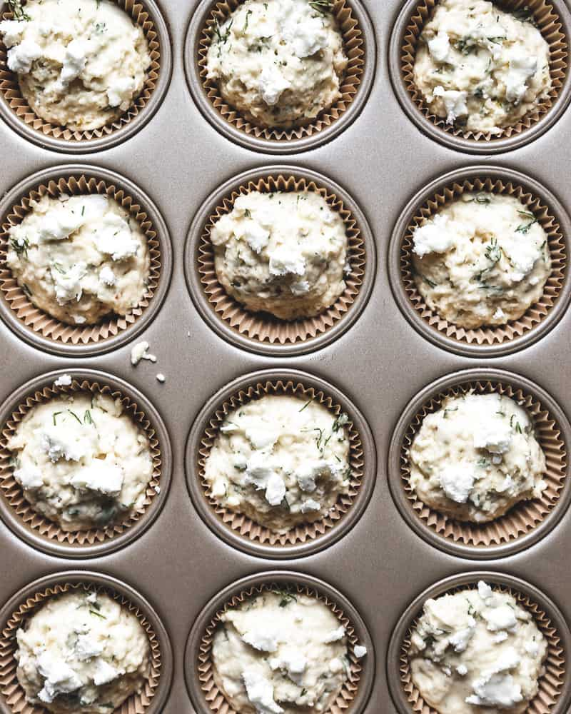 muffin batter scooped into muffin liners