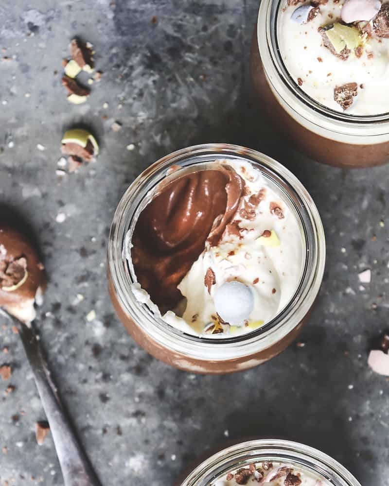 close up of chocolate pots de crème with spoon