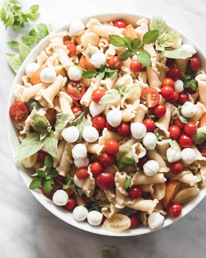 bowl of campanelle caprese pasta on marble surface